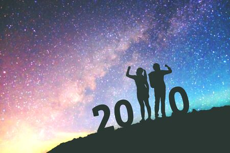 2020 Newyear  Couple celebration success of 2020 Happy new year background on  the Milky Way galaxy