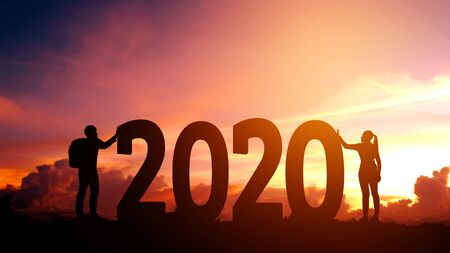 2020 Newyear  Couple tries to push number of 2020 Happy new year concept 스톡 콘텐츠