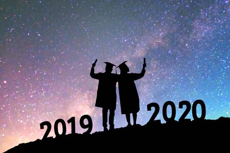 2020 New year Silhouette people graduation in 2020 years education congratulation concept background on  the Milky Way galaxy 스톡 콘텐츠