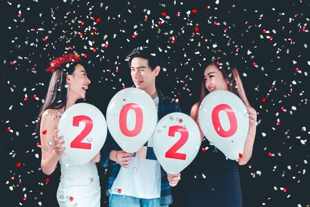 2020 Newyear party ,celebration party group of asian young people holding balloon numbers 2020 happy and funny concept