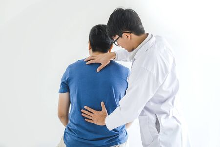 Physical Doctor consulting with patient about Back problems Physical therapy concept