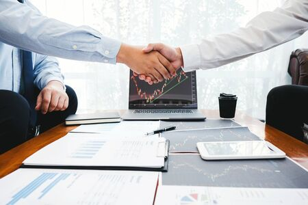 Business Team shaking hands with Investment Entrepreneur Trading discussing and analysis graph stock market trading,stock chart concept
