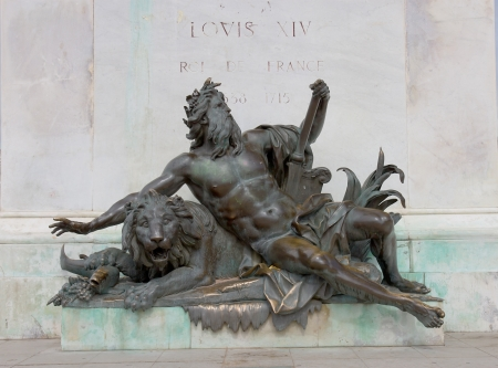 allegorical: Allegorical statue of the Rhone river, under the statue of Louis XIV  Bellecour square, Lyon, France