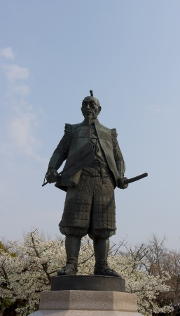 Statue of Toyotomi Hideyoshi  in Hokoku Jinja shrine near Osaka castle during cherry blossom  Osaka, Japan  Stock Photo - 15157072