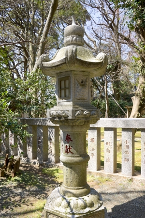 Traditional Japanese stone lantern  toro  in the temple garden  Kamakura, Japan  photo
