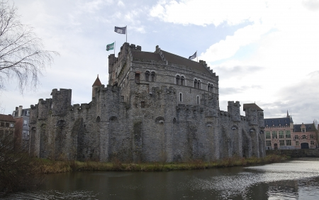 Gravensteen castle (circa 1180). View from Lieve river. Ghent, East Flanders, Belgium Stock Photo - 17201903