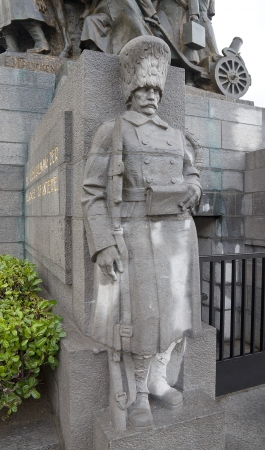 made in belgium: Statue of Belgian grenadier of WWI. Fragment of Infantry Memorial made by Edouard Vereycken. Place Poelaert, Brussels, Belgium