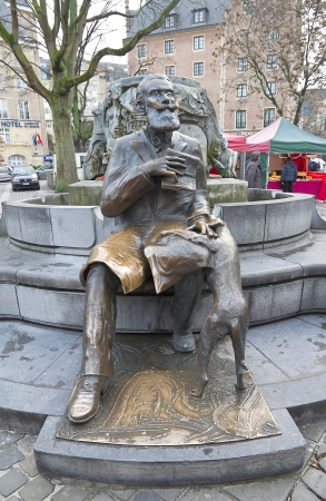 belgie: Statue of  Charles Karel Buls (1837-1914), the mayor (in 1881-1899) of the City of Brussels. Fragment of the Charles Karel Buls fountain, Agora Square, Brussels, Belgium Editorial