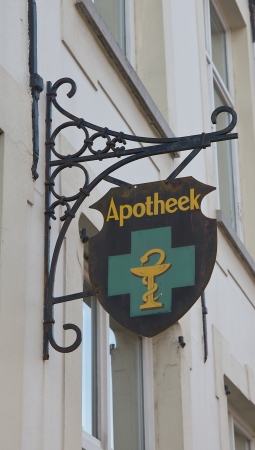 belgie: Retro style signboard of a pharmacy on the street of historic center of Bruges  UNESCO World Heritage Site , West Flanders, Belgium  Editorial