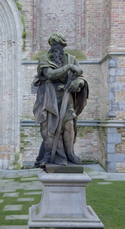 apostle paul: Statue of the Apostle Paul  in front of Sint-Salvator Cathedral (Sint-Salvatorskathedraal, circa XIX c.).  Stock Photo