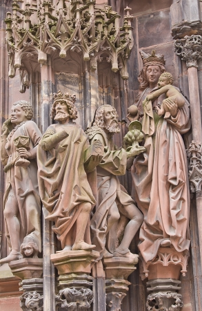 laurent: Sculpture Adoration of the Magi. St. Laurent portal of the Cathedral of Our Lady of Strasbourg (Cathedrale Notre-Dam, circa 1439) Stock Photo