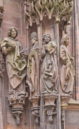 laurent: Sculpture of Saint Laurent with followers. St. Laurent portal of the Cathedral of Our Lady of Strasbourg (Cathedrale Notre-Dam, circa 1439)