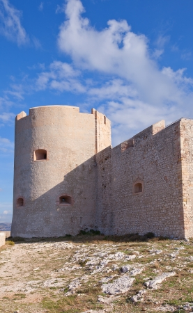 monte cristo: Saint Christopher Tower (main keep) of If castle (circa 1531). Castle is famous for being one of the settings of Alexandre Dumas adventure novel The Count of Monte Cristo. If island, Marseilles, France Editorial