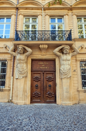 telamon: Decorated portal with atlantes figures of Hotel Maurel de Ponteves  circa 1650, nowadays serves as Commercial Court    Aix-en-Provence, France