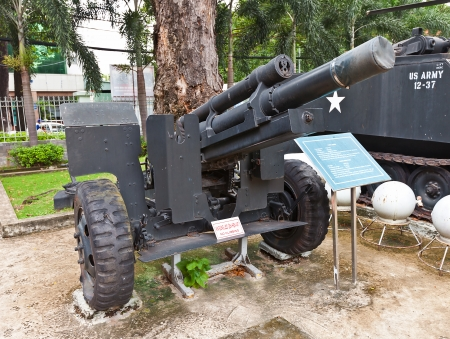 gunnery: USA M101 105 mm howitzer on the yard of War Remnants Museum  Ho Chi Minh city, Vietnam  This model of howitzer was used by USA in Vietnam War Editorial