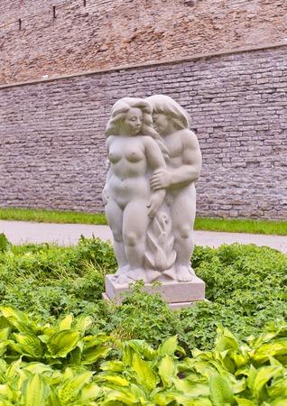 e 27: Tallinn, Estonia - May 27, 2014  White marble sculpture of nude woman and man  circa 2008   Sculptor E  Kolk  Superintendent garden  Komandandi aed , historical center of Tallinn, Estonia  UNESCO site