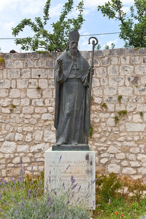 friar: Monument  circa 2001  to Augustin Kazotic, a medieval Dominican friar, an orator and bishop of Zagreb  Historical center of Trogir  Croatia