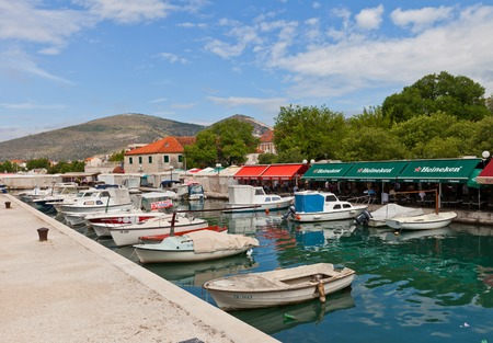 excursions: Trogir, Croatia - June 16, 2014  Harbour for small boats in Trogir, Croatia  Boats are using by locals for fishing, excursions for tourists and as transportation between islands