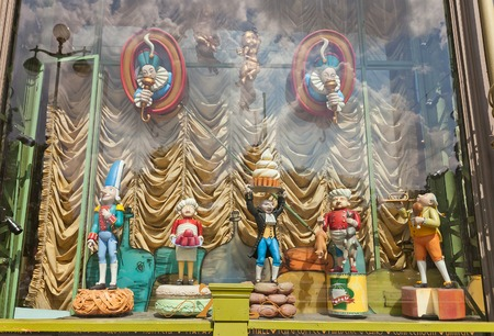 emporium: Russia, Saint Petersburg - July 14, 2014  Mechanical dolls in store front window of Elisseeff Emporium in Saint Petersburg