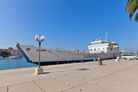 TROGIR, CROATIA - JULY 20, 2014  Local line ferry Soltanka of Jadrolinija liner shipping company at waterfront of Trogir, Croatia  Ferry capacity 200 people and 30 cars
