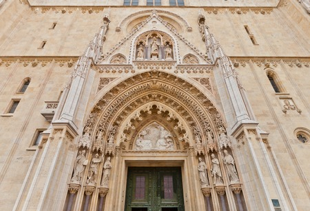 saint stephen cathedral: Entrance portal of Zagreb cathedral  founded in XI c , current view since XVIII c  , Croatia  Cathedral is dedicated to the Assumption of Mary and to kings Saint Stephen and Saint Ladislaus Stock Photo