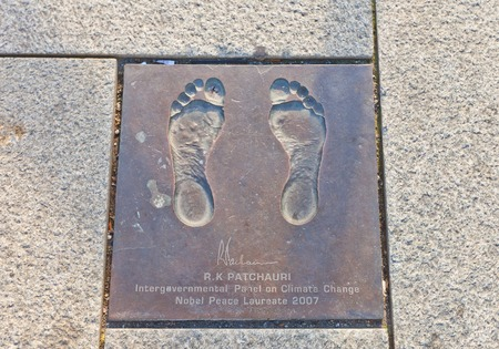 STAVANGER, NORWAY - AUGUST 16, 2014: Bronze cast of bare feet of Rajendra Kumar Pachauri, Nobel Peace laureate in Stavanger, Norway. Part of Path of Peace, the project of human rights foundation Point of Peace