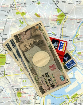 Concept  traveling to Tokyo (Japan). Japanese money (yens), Visa credit cards, Tokyo city map