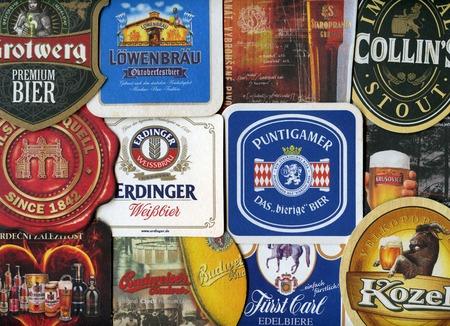 Beermats (bierdeckel) background. Various beer trademarks