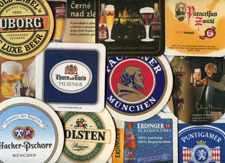 MOSCOW, RUSSIA - AUGUST 29, 2014: Beermats (bierdeckel) background. Various beer trademarks  Editorial