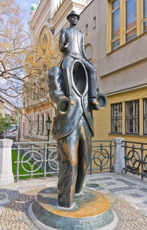 existentialism: PRAGUE, CZECH REPUBLIC - APRIL 13, 2012: Monument to famous writer Franz Kafka in Jewish Quarter of Prague. Unusual memorial was inaugurated in 2003, work of sculptor Jaroslav Rona. Editorial