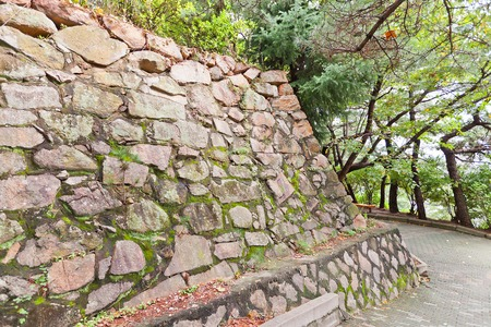 invade: BUSAN, SOUTH KOREA - SEPTEMBER 25, 2014:  Stone walls, the only survived structure of Busan castle in Busan town (Republic of Korea). Was built by Japanese invaders in 1592 during Imjin War Editorial