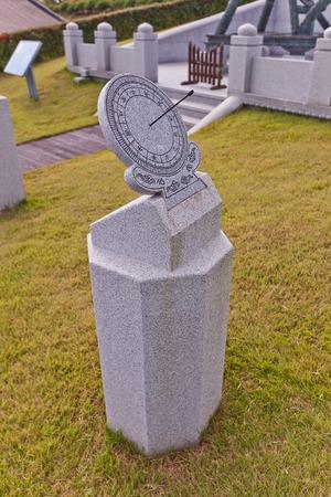astronomer: BUSAN, SOUTH KOREA - SEPTEMBER 25, 2014:  Equatorial sundial in Science Garden of Dongnae castle in Busan, Korea. Garden commemorates the achievements of Jang Yeong-sil, a Korean scientist and astronomer of XIV c.