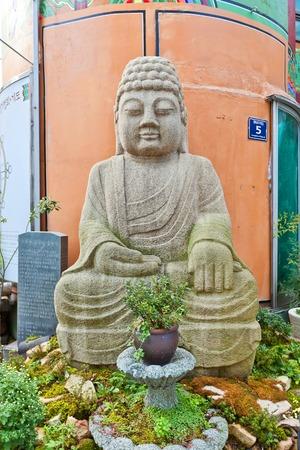 BUSAN, SOUTH KOREA - SEPTEMBER 25, 2014:  Buddha statue of Buddhist temple on Gwangbok street in Busan, Republic of Korea. Temple located on the foot of Yongdusan Park