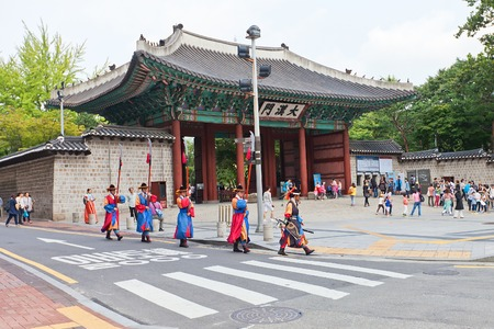 historically: SEOUL, SOUTH KOREA - SEPTEMBER 27, 2014: Historically dressed soldiers arriving to the Royal Guards Ceremony near Taehanmun Gate of Deoksugung Palace in Seoul, Korea