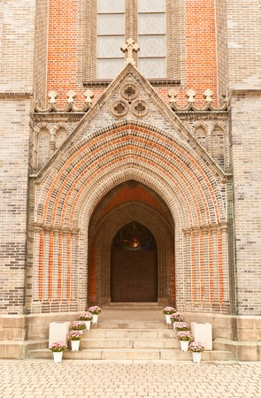 archbishop: SEOUL, SOUTH KOREA - SEPTEMBER 28, 2014: Entrance portal of Myeongdong Cathedral of the Virgin Mary of the Immaculate Conception (circa 1898) in Seoul, Korea. Seat of the Archbishop of Seoul, National Historic Site No258 Editorial