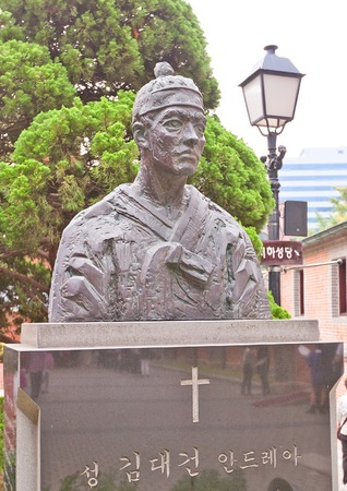 martyr: SEOUL, SOUTH KOREA - SEPTEMBER 28, 2014: Monument to Saint Andrew Kim Taegon in the yard of Myeongdong Cathedral of the Virgin Mary in Seoul, Korea. Kim Taegon (1821-1846) was the first Korean-born Catholic priest and martyr
