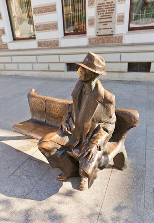 julian: LODZ, POLAND - OCTOBER 19, 2014: Monument to Polish poet Julian Tuwim (1894-1953) in Lodz, Poland. Sculpture known as Tuwim Bench is a work of sculptor Wojciech Gryniewicz, 1999 Editorial