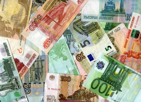 monetary devaluation: European currency (Euro) and Russian banknotes (Rubles) background