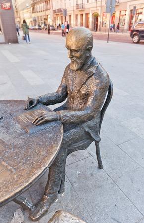 LODZ, POLAND - OCTOBER 19, 2014: Monument to Polish textile magnate Izrael Kalmanowicz Poznanski (1833-1900) in Lodz, Poland. Part of sculpture Lodz Manufacture Creators by Marcel Szytenchelm, 2002
