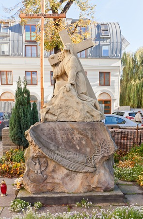 pentecost: LODZ, POLAND - OCTOBER 19, 2014: Sculpture of Jesus Christ with a Cross near Catholic Basilica of Pentecost in Lodz, Poland. Erected in 1946 to commemorate anniversary of Polish Army