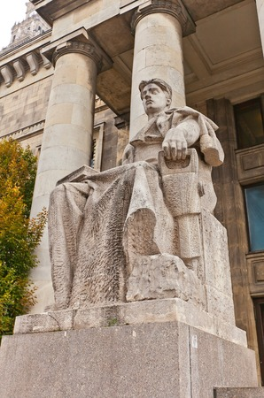 pitman: WARSAW, POLAND - OCTOBER 18, 2014: Allegorical sculpture of a worker (circa 1955) in front of Technical Museum, part of Palace of Culture and Science in Warsaw, Poland