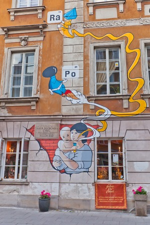 laureate: WARSAW, POLAND - OCTOBER 18, 2014:  Mural on birthplace of Nobel laureate Maria Sklodowska-Curie in Warsaw, Poland. Mural shows (infant) Maria holding a test tube with elements she discovered: polonium and radium. Editorial