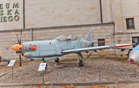 monoplane: WARSAW, POLAND - OCTOBER 20, 2014:  Polish trainer aircraft PZL PZL 130 Orlik (Eaglet)  in Museum of Polish Army in Warsaw, Poland. Used from 1994 by the Polish Air Force