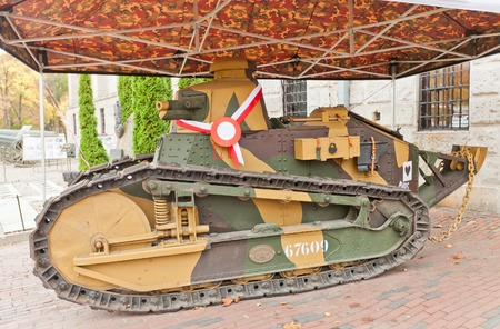 progenitor: WARSAW, POLAND - OCTOBER 20, 2014:  French light tank Renault FT-17 (circa 1917) in Museum of Polish Army in Warsaw, Poland. The progenitor of most contemporary tanks