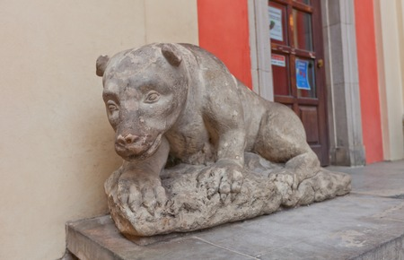 jesuit: WARSAW, POLAND - OCTOBER 20, 2014:  Sculpture of a bear near the entrance of Jesuit Church of the Gracious Mother of God in Warsaw, Poland. Sculptor Jan Jerzy Plersch, circa XVIII c.