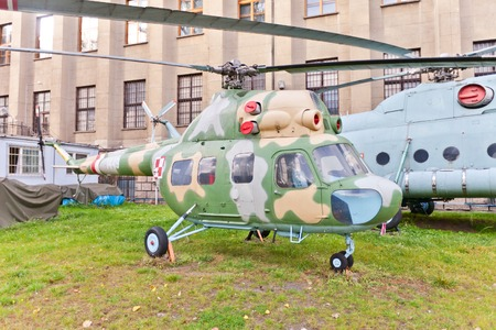 armaments: WARSAW, POLAND - OCTOBER 20, 2014:  Soviet light multifunctional helicopter Mil Mi-2 (NATO reporting name Hoplite) in Museum of Polish Army in Warsaw, Poland. Was produced exclusively in the WSK PZL-Swidnik factory in Poland Editorial