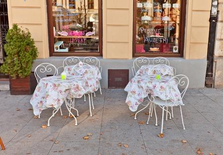 krakowskie przedmiescie: WARSAW, POLAND - OCTOBER 20, 2014:  Street cafe on the central Krakowskie Przedmiescie street in Warsaw, Poland Editorial