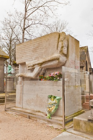 dorian: PARIS, FRANCE - FEBRUARY 21, 2015: Grave of Oscar Fingal OFlahertie Wills Wilde on Pere Lachaise Cemetery in Paris. Oscar Wild (1854-1900) was a an Irish writer and poet, author of novel The Picture of Dorian Gray Editorial