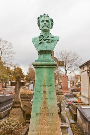 commune: PARIS, FRANCE - FEBRUARY 21, 2015: Tomb of Frederic Etienne Cournet on Pere Lachaise Cemetery in Paris. Frederic Cournet (1837-1885) was a French journalist, known for his role during the Paris Commune