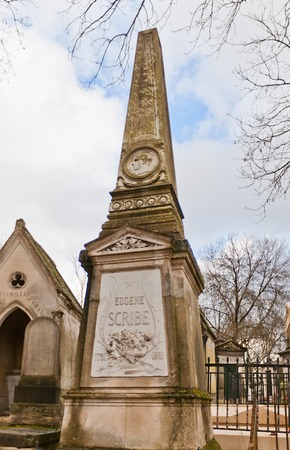 dramatist: PARIS, FRANCE - FEBRUARY 21, 2015: Tomb of Augustin Eugene Scribe on Pere Lachaise Cemetery in Paris. Eugene Scribe (1791-1861) was a French dramatist and librettist of many of the most successful grand operas